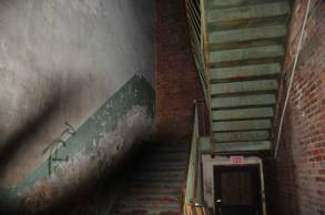 This photo was taken with a flash in a dark stairwell. Note the shadow on the left, climbing the stairs and the wall.